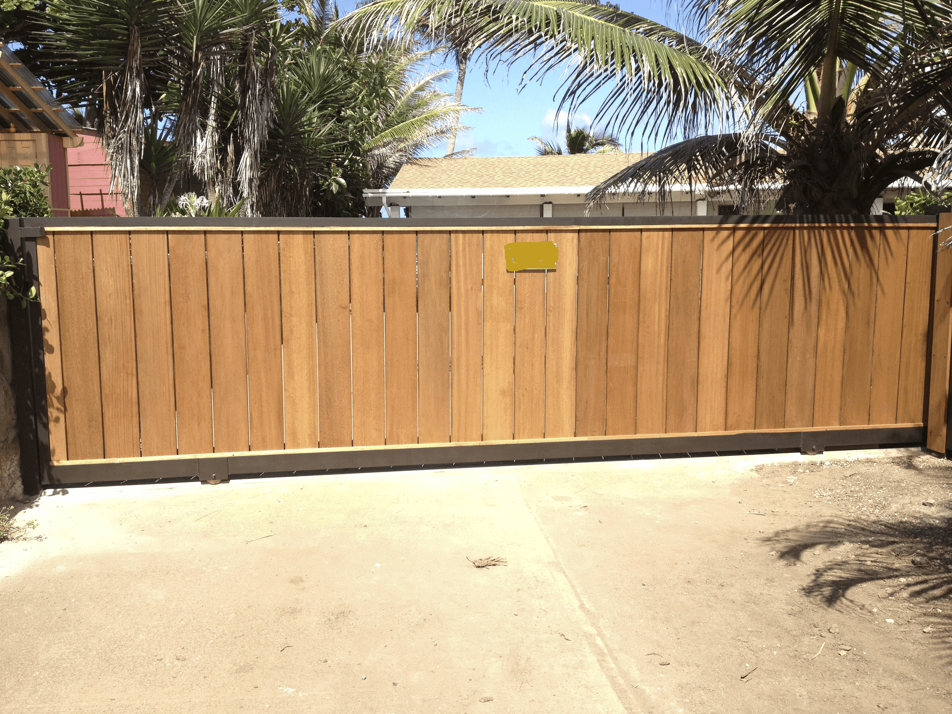 Sliding wood gate built for a residential property in Hauula