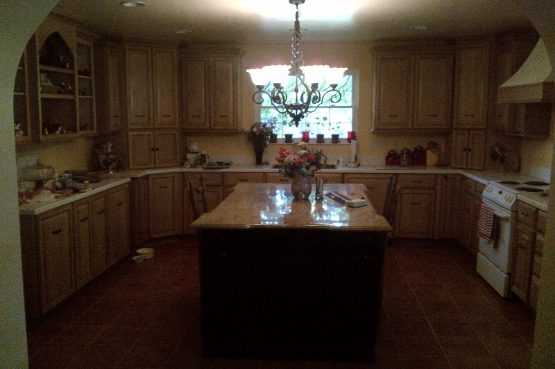 kitchen with chandelier and large granite top island