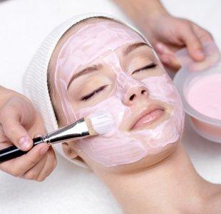 applying cream on face