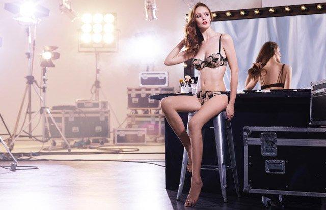 Women sitting on a stool wearing a lingerie set