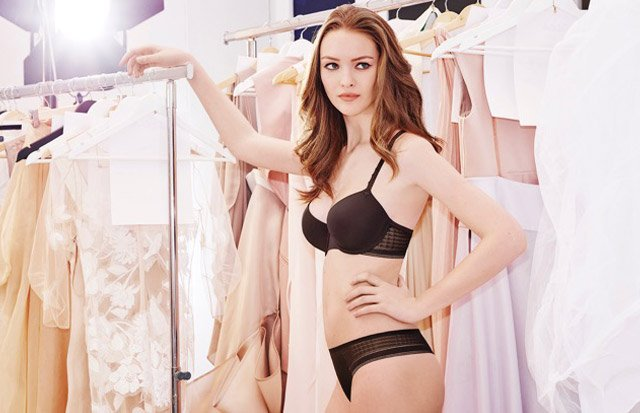Young women standing in black lingerie set