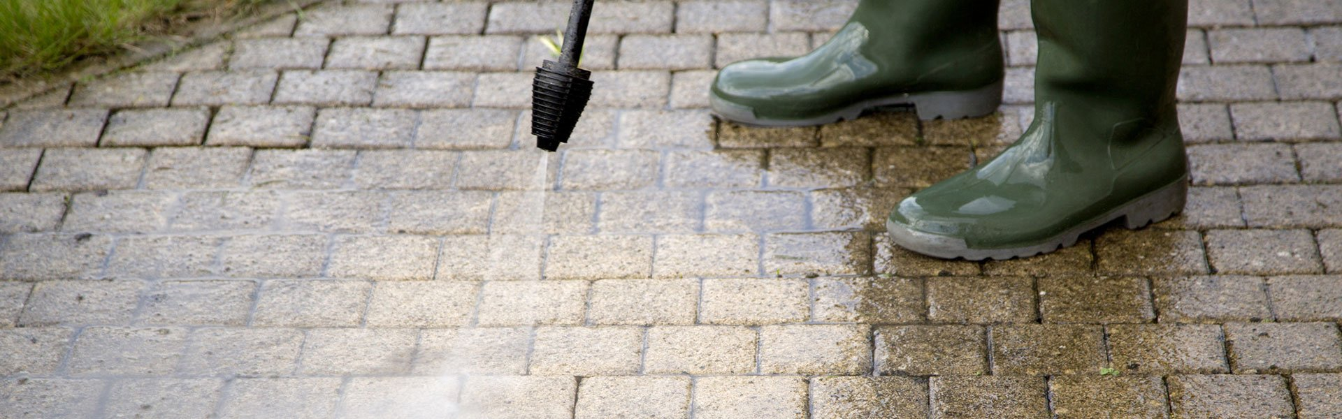 A Skilled Cleaner Using Pressure Washing System For Patio Cleaning