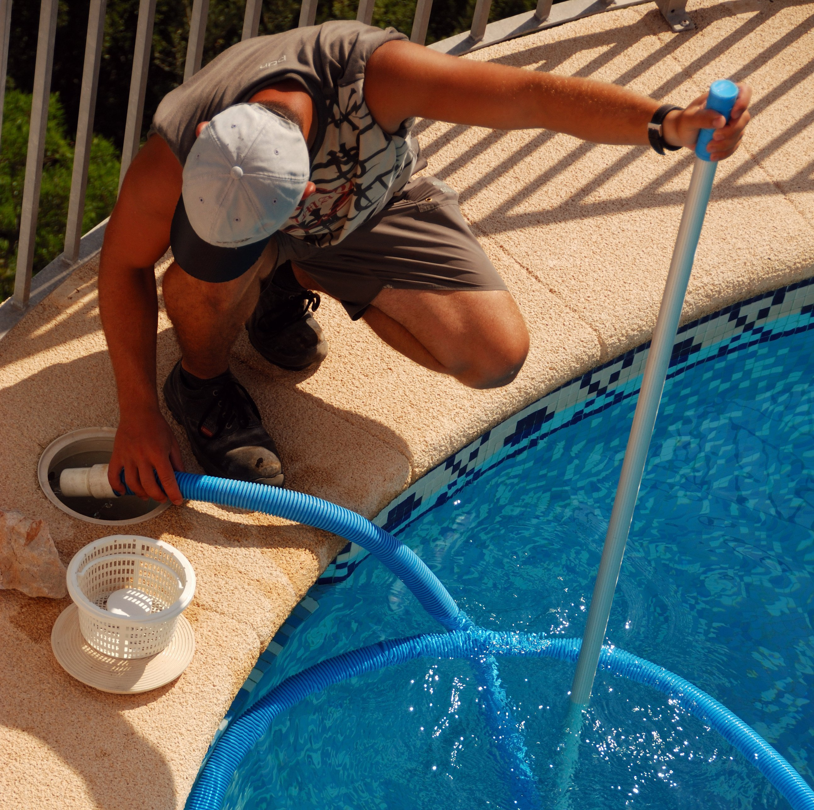 Worker doing swimming pool repair in Cincinnati, OH