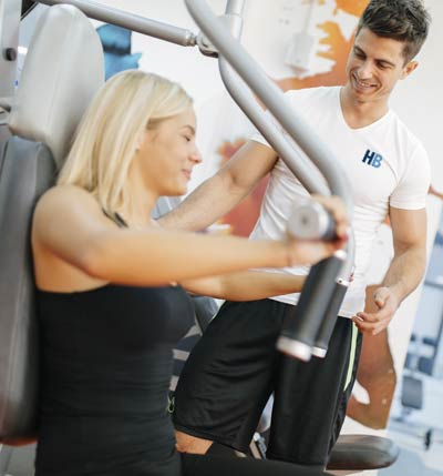 HomeBodies NYC Personal Trainer for Women Doing Weight Training