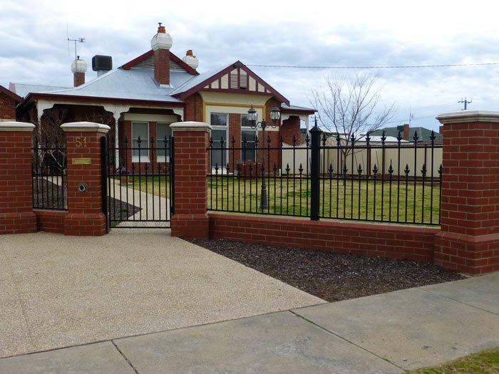 brick house with iron fence
