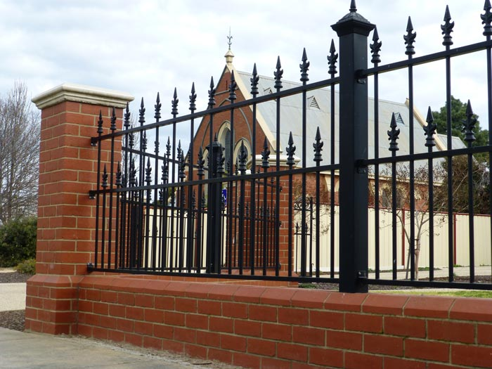 building with brick and iron fence