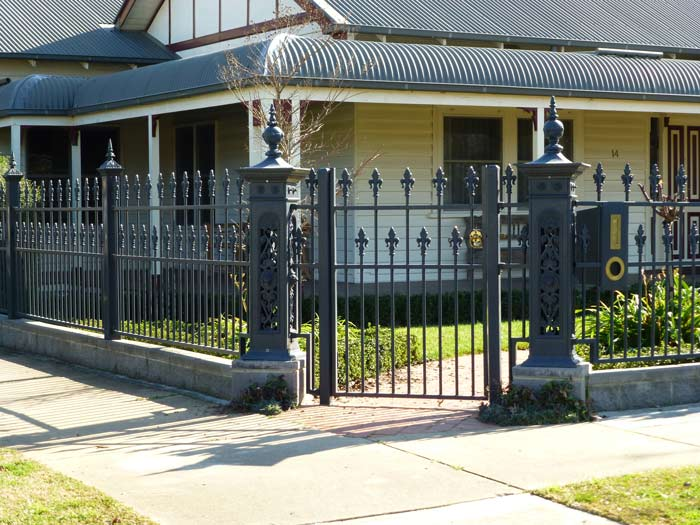 house with iron fence