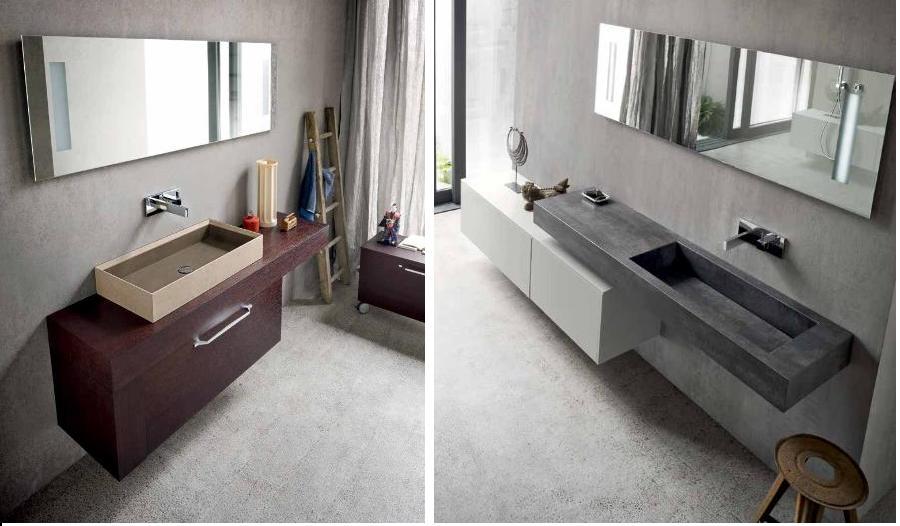 specchi e lavabi con parete in marmo in un bagno moderno