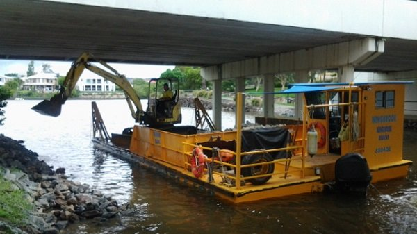 Excavator hire under a bridge on the gold coast