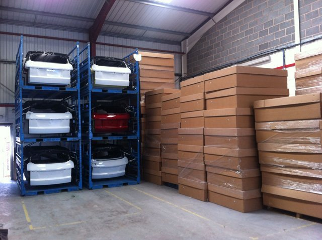 ar parts and cardboard boxes in storage at Panache Coatings