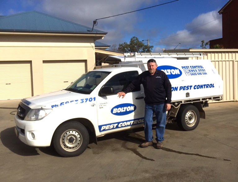 bolton pest control staff with vehicle