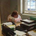 Elaine Willkinson working on accounts