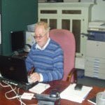 Peter Williams working at a computer on a desk