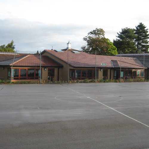 A new school building with large playground