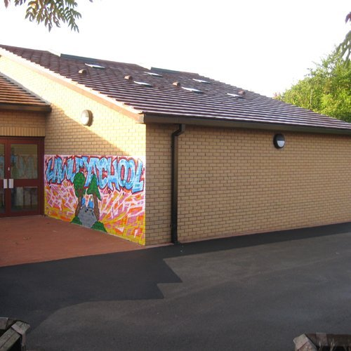The side of the school with a murial