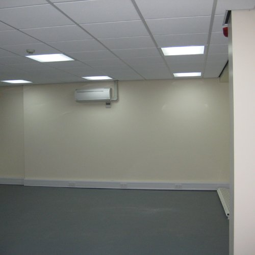 The inside of an empty room with a new air conditioning unit