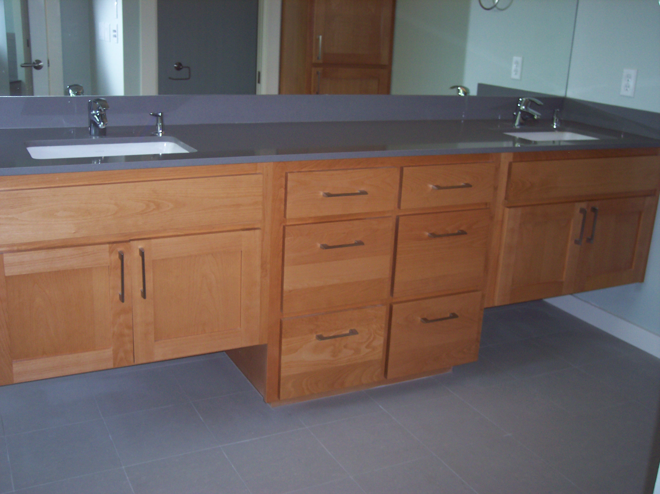 contemporary bathroom cabinets with two sinks by JB Murphy Company custom cabinet builders