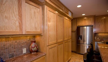 custom kitchen cabinetry by JB Murphy Company with wall to wall red oak wood