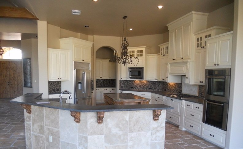 JB Murphy Co. custom kitchen design painted white with gray granite counter tops