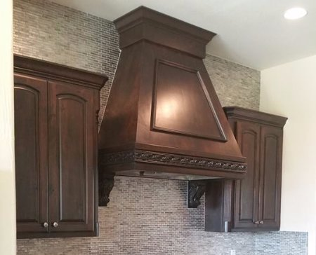 custom wood stove vent hood in dark wood by JB Murphy Co.