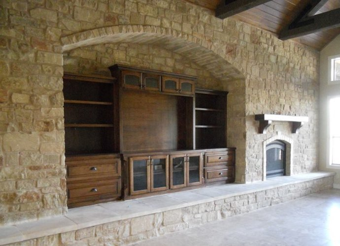 custom made entertainment center with fireplace that has a custom mantel by JB Murphy Co. custom cabinet builders