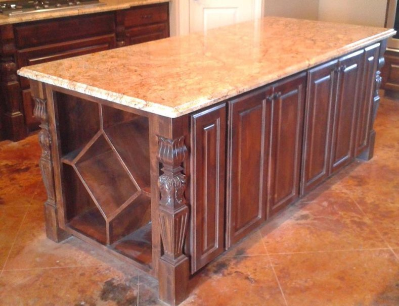 custom kitchen island with wine rack on side and detailed trim by JB Murphy Co.