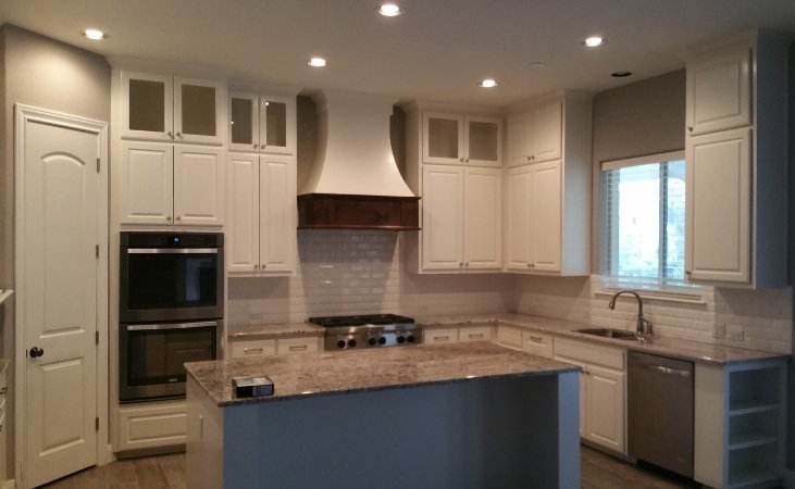 Custom kitchen cabinets with kitchen island by JB Murphy Co.