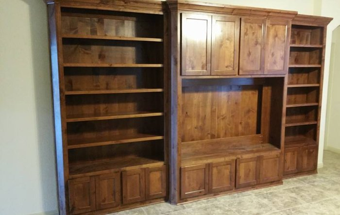 large custom entertainment center with shelving by JB Murphy custom cabinet makers
