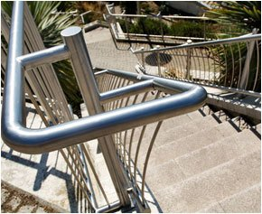 A stainless steel staircase bannister