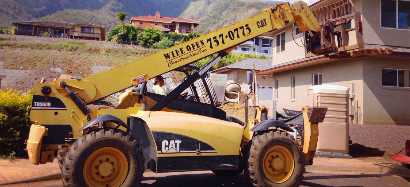 Cat loader used by Wide Open construction company in Maui, HI