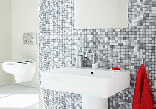un lavabo, e vista di un wc in un bagno con piastrelle bianche e grigie