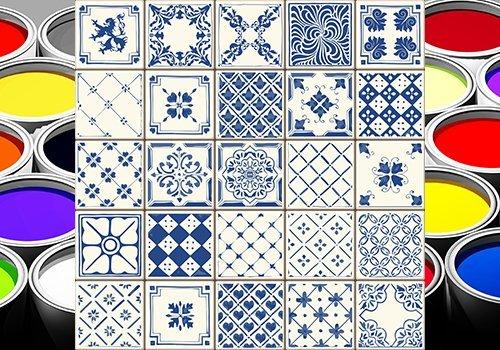 delle piastrelle a disegni bianchi e blu e dei barattoli di vernice