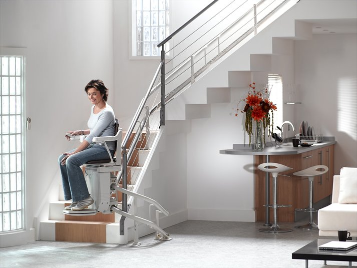 Woman sitting on stairlift