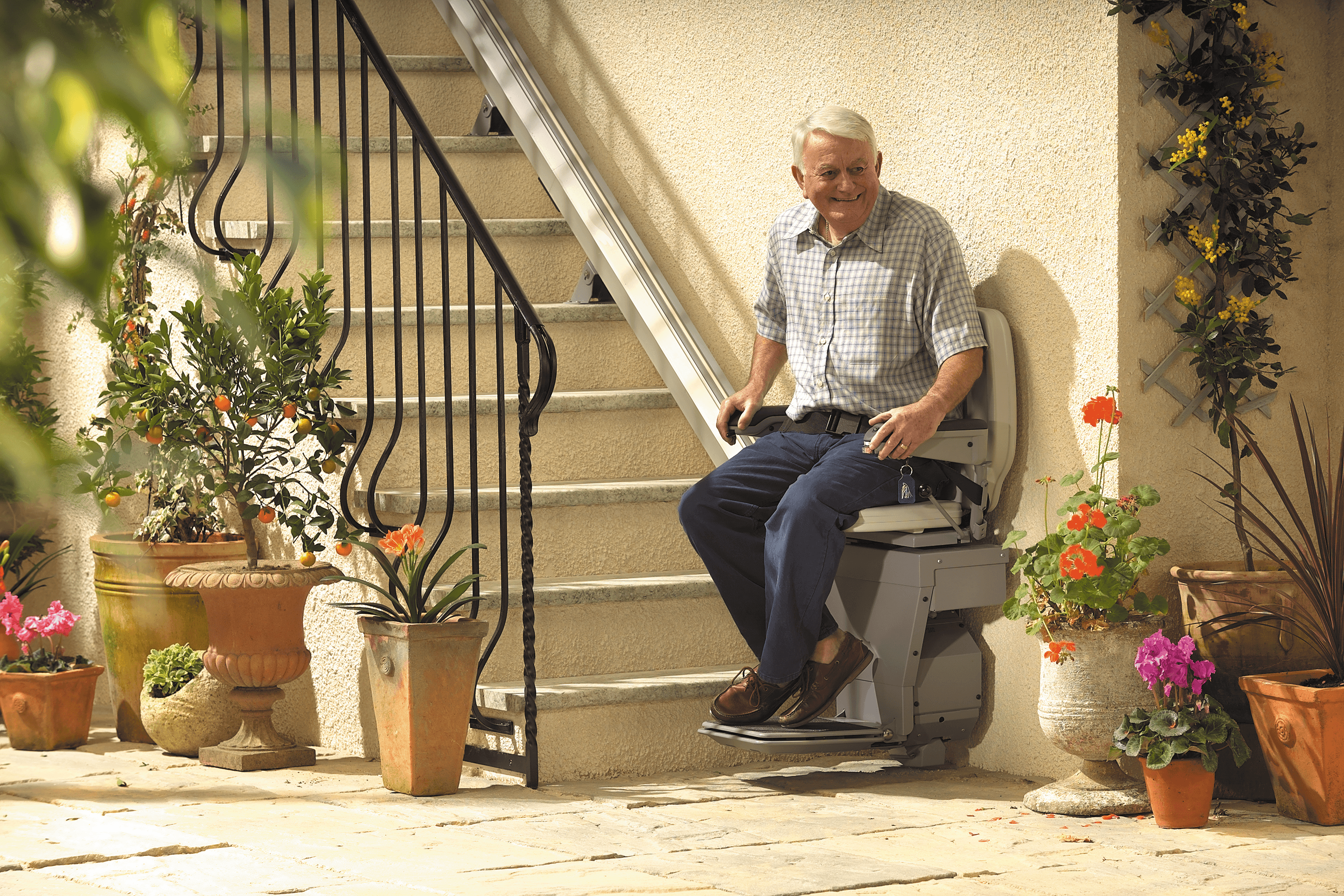 Senior man sitting on stairlift