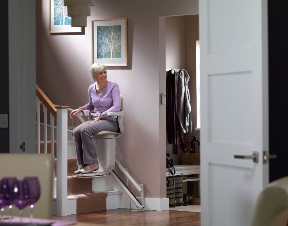 woman sitting on a chair lifting a home in New Zealand