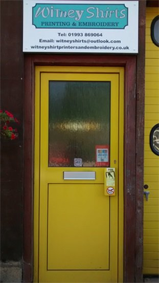 yellow door with stained glass