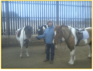 Riding intructor with horses