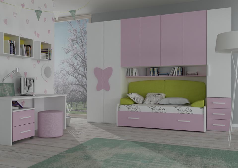 una cameretta con un letto singolo e degli armadi di color bianco e lilla