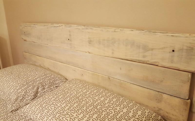 Testata del letto in legno