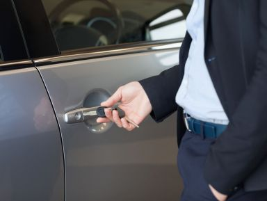 Man unlocking car after our locksmith services in Huntersville, NC