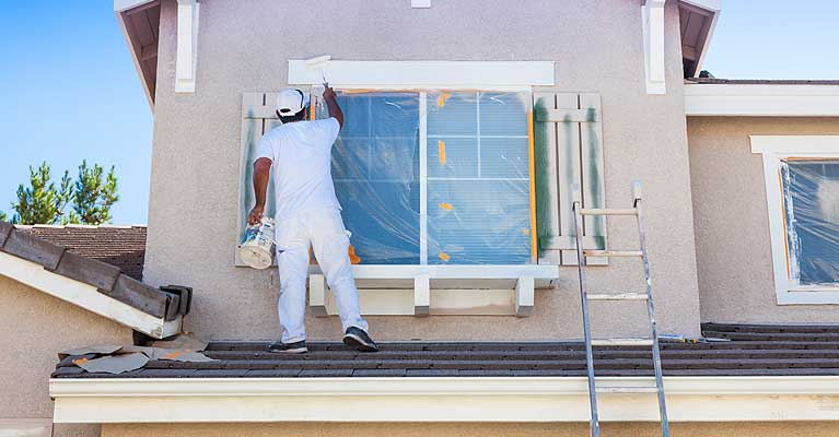 house-painter-working-on-house