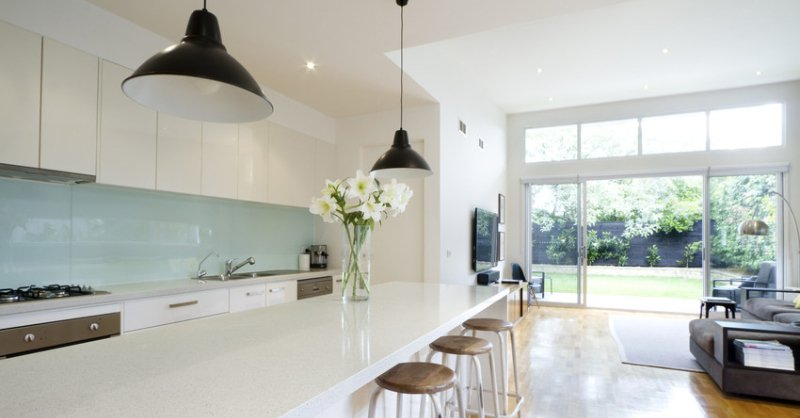 A large modern style kitchen with breakfast bar
