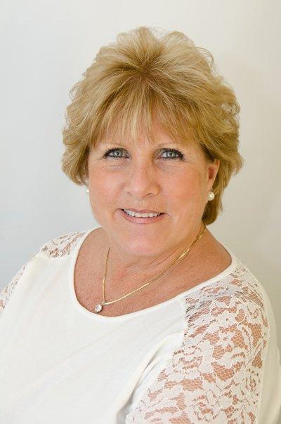 Joan Caputo, Office Manager