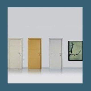 Porte Dierre per interni in Essenza e Laccate intaglio