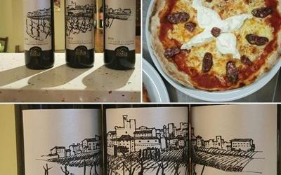 pizza farcita con delle bottiglie di vino