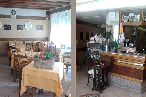 tavoli all'interno del ristorante e banco con la cassa