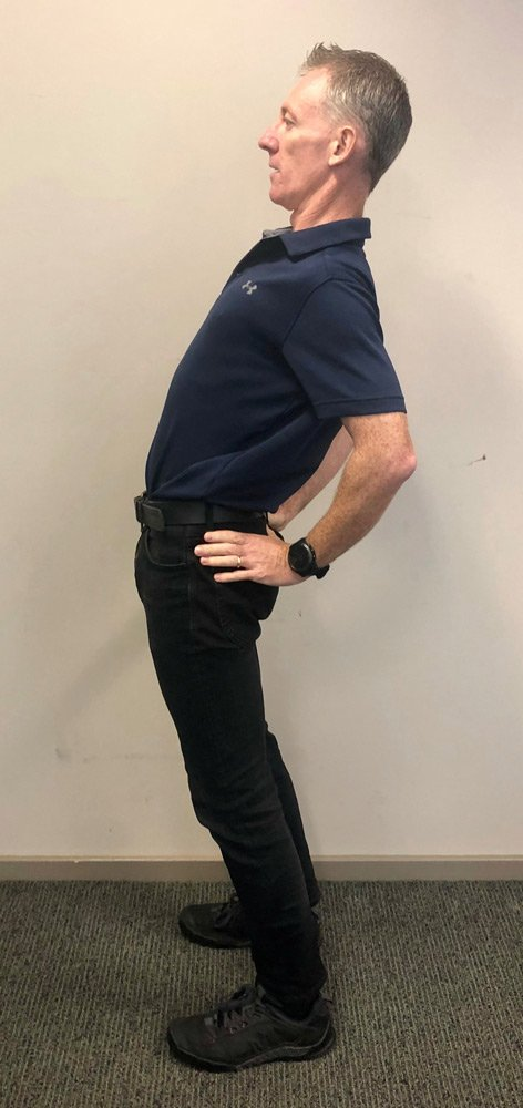 man doing back extensions while standing