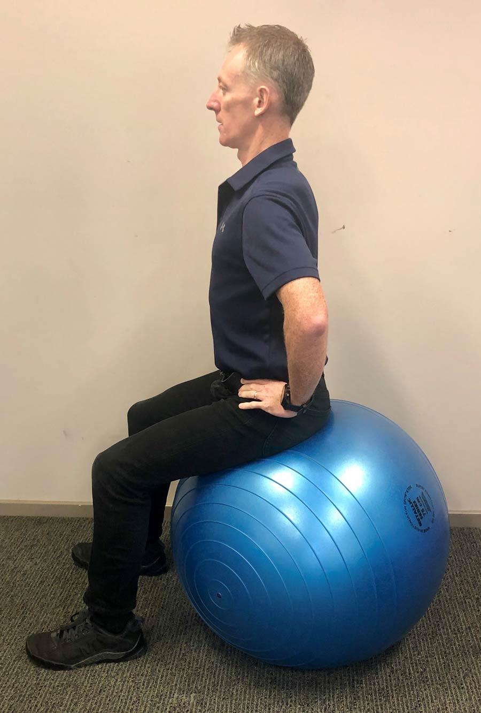 man maintaining sitting posture