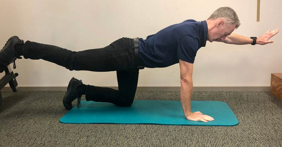 man doing core exercises on floor
