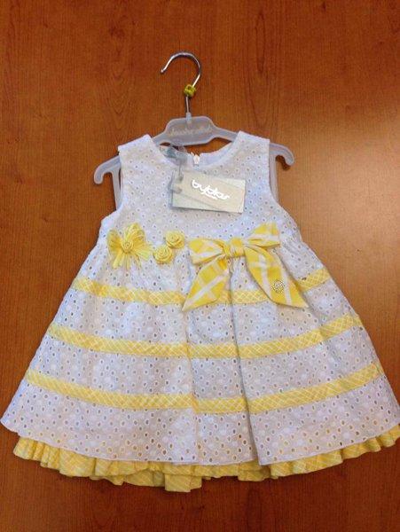 vestitino per bambina con fiocchi e righe gialle
